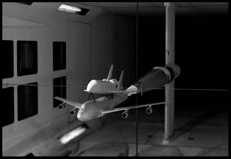 This November 6, 1975 photo shows a scale model of the Space Shuttle attached to a 747 carrier, inside NASA's 7 x 10 wind tunnel. (NASA)
