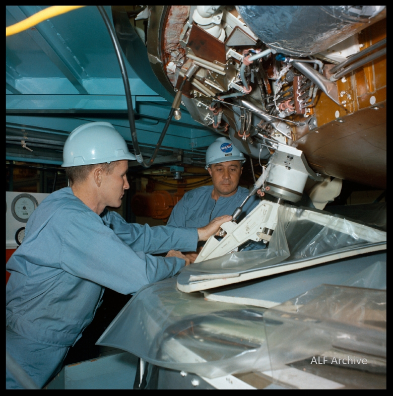 Ed White and Gus Grissom inspect Apollo Command Module at North American Rockwell in Downey, California. 1966