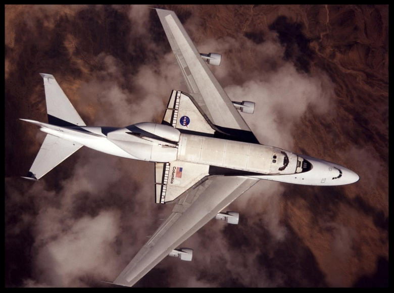 NASA space shuttle Columbia hitched a ride on a special 747 carrier aircraft for the flight from Palmdale, California, to Kennedy Space Center, Florida, on March 1, 2001.  Image- NASA