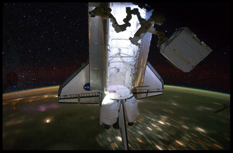 Above: The docked space shuttle Endeavour, backdropped by a nighttime view of Earth and a starry sky are featured in this image photographed by an Expedition 28 crew member on the International Space Station, on May 28, 2011.