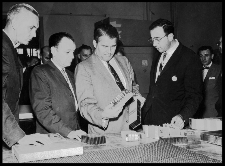 This is a photograph of Dr. von Braun, taken in 1961, visiting North American Aviation's Space and Information Systems Division in Downey, California. Dr. Harrison Storms to Wernher von Braun's left was President of NAA Space Division in Downey.