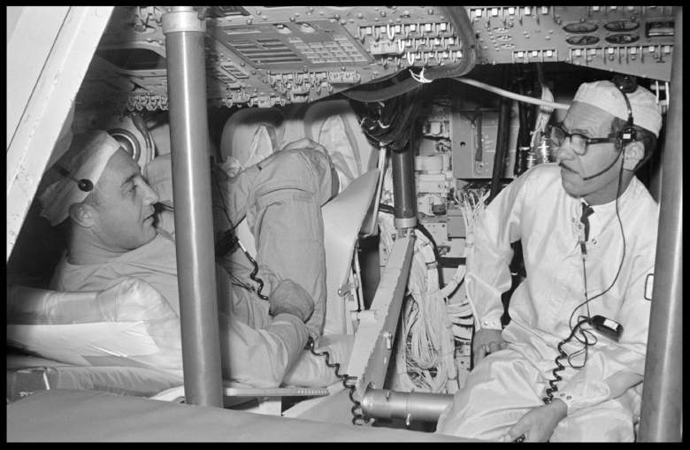 Astronaut Virgil I. Grissom and other members of the first Apollo crew inspect spacecraft equipment during a visit to North American Aviation. NORTH AMERICAN AVIATION, INC., DOWNEY, CA (June 24, 1966).