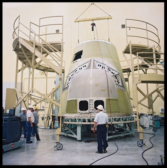 The crew module initial build continues in  Bldg 290  high bay at the Rockwell Downey facility.