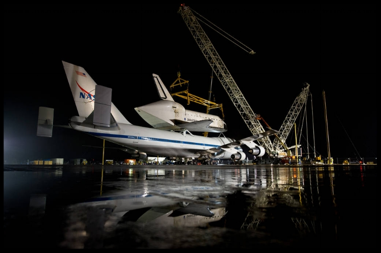 NASA's Shuttle Carrier Aircraft with the space shuttle Discovery mated on top rolls into position for demating at Washington Dulles International Airport, Wednesday, April 18, 2012, in Sterling, VA.  Image- NASA