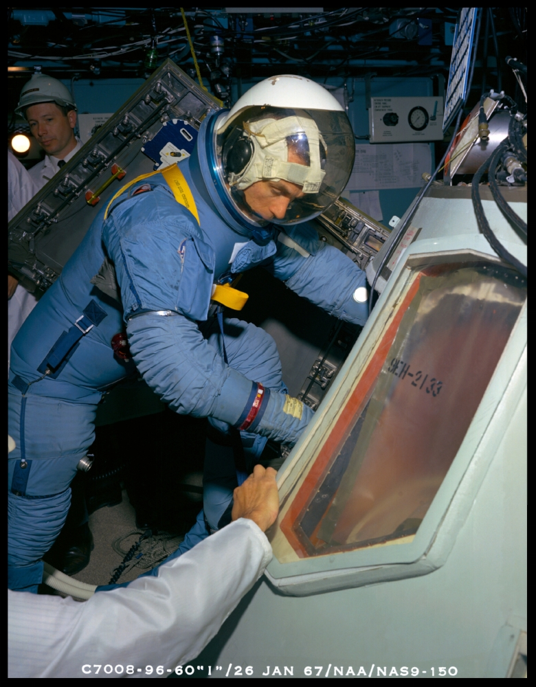 Astronaut Eugene A. Cernan, wearing Block II A5L Pressure Garment Assembly, ingressing Apollo SC 101 CM during Apollo Crew Compartment Fit and Function C2F2 Test. North American Aviation, Inc., Downey, Calif. 1967 . NASA Image