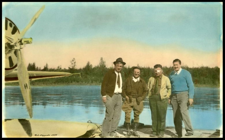 During the summer of 1935, Wiley Post and the famous American humorist, Will Rogers, ventured north to the territory. From left to right, Rogers, famous Alaskan musher Leonhard Seppala, Post, and famous bush pilot Joe Crosson stand near Post's Lockheed monoplane on a floatplane dock on the Chena River near Fairbanks. Against Crosson's advice, Post and Rogers pushed on from there and died in an airplane crash near Barrow.  Smithsonian Air and Space