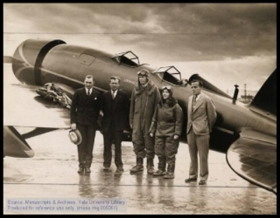 Charles A. Lindbergh and Anne Morrow Lindbergh with their Lockheed Sirius airplane. Jerry Vultee far right.