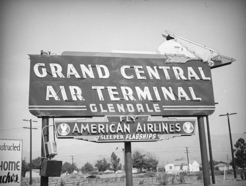 A wing and arrow top this neon sign for the Grand Central Air Terminal, located at 1310 Air Way in Glendale. 1937.jpg