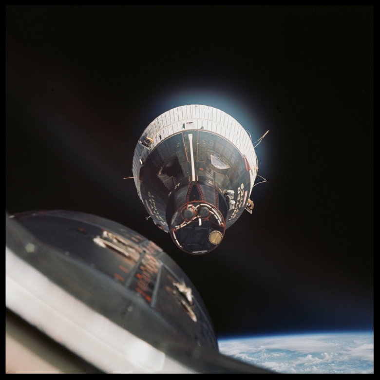A photograph of the Gemini VII spacecraft - nose towards camera - was taken from the Gemini VI spacecraft during rendezvous and station keeping maneuvers 1965.jpg
