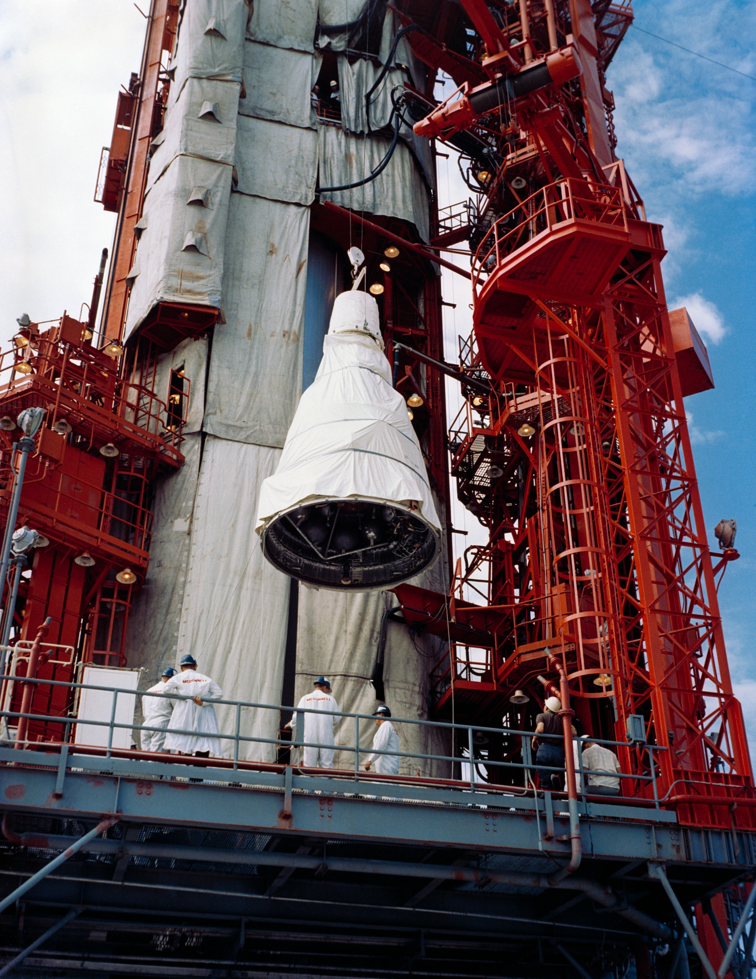 The GT-V Spacecraft is hoisted to the top of the gentry at Pad 19 to be mated with the Gemini Launch Vehicle (GLV)-V. CAPE KENNEDY, FL
