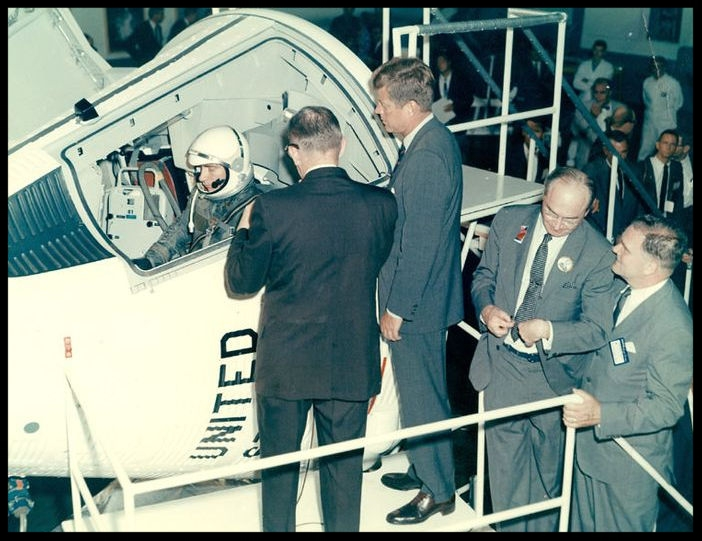 Above- President John F. Kennedy looks over a Gemini space capsule with Astronaut John Young