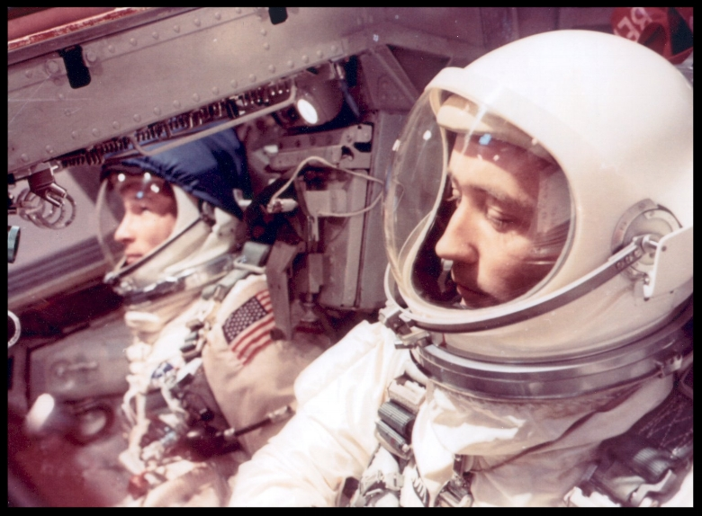 Above- Astronauts Edward H. White II (left) and James A. McDivitt inside the Gemini IV spacecraft wait for liftoff.  1965