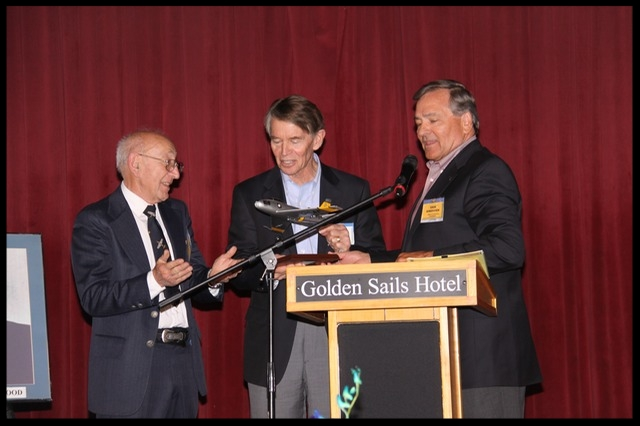 James Kindelberger Graham (center) accepts a beautiful F-86 scale model from the North American Aviation Bald Eagles at their 55th and final luncheon.