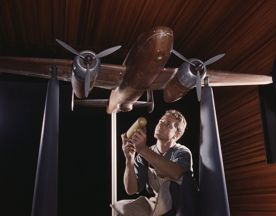 An experimental scale model of the B-25 plane is prepared for wind tunnel tests in the plant of the North American Aviation, Inc., Inglewood, Calif 1942
