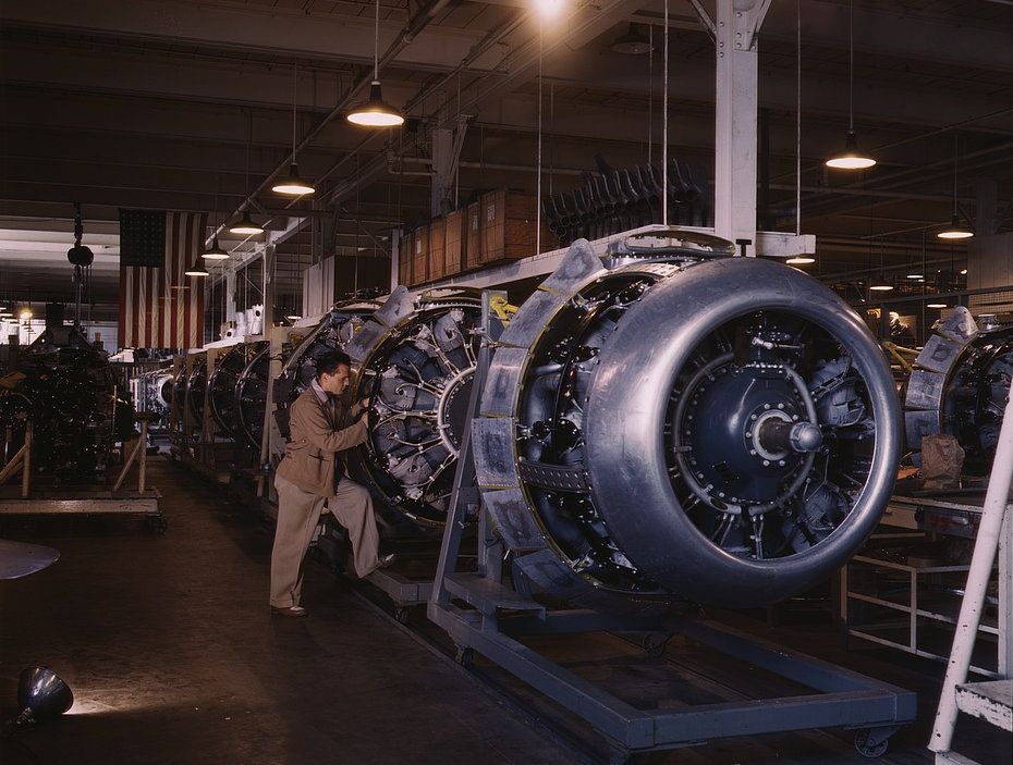 Cowling and control rods are added to motors for North American B-25 bombers as they move down the assembly line, North American, Inc., Inglewood, Calif. 1942