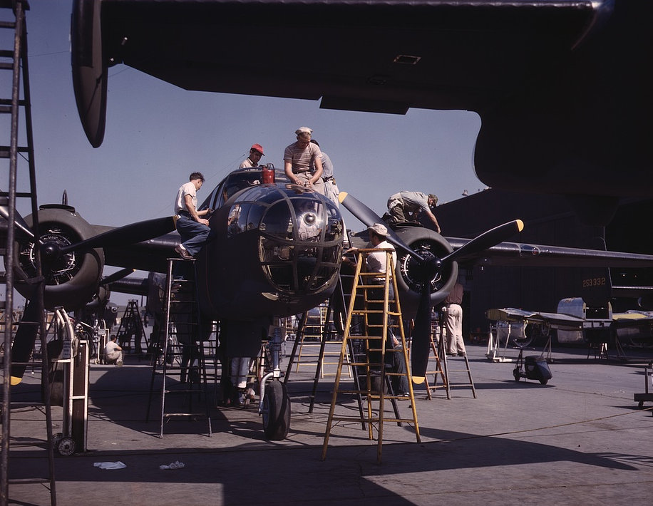 Employees on the Sunshine assembly line at North American's plant put the finishing touches on another B-25 bomber, Inglewood, Calif. 1942