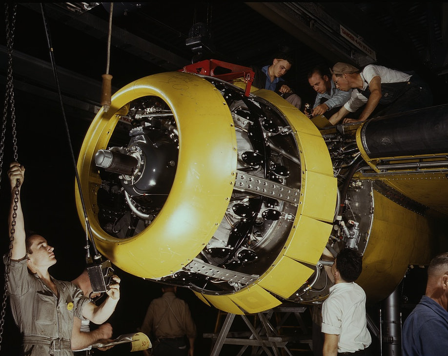 Mounting motor on a Fairfax B-25 bomber, at North American Aviation, Inc., plant in [Inglewood], Calif. 1942
