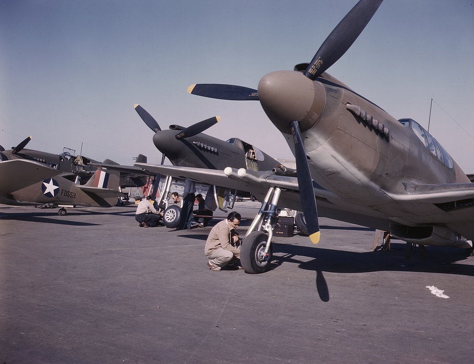 P-51 (Mustang) fighter planes being prepared for test flight at the field of the North American Aviation, Inc., plant in Inglewood, Calif. 1942