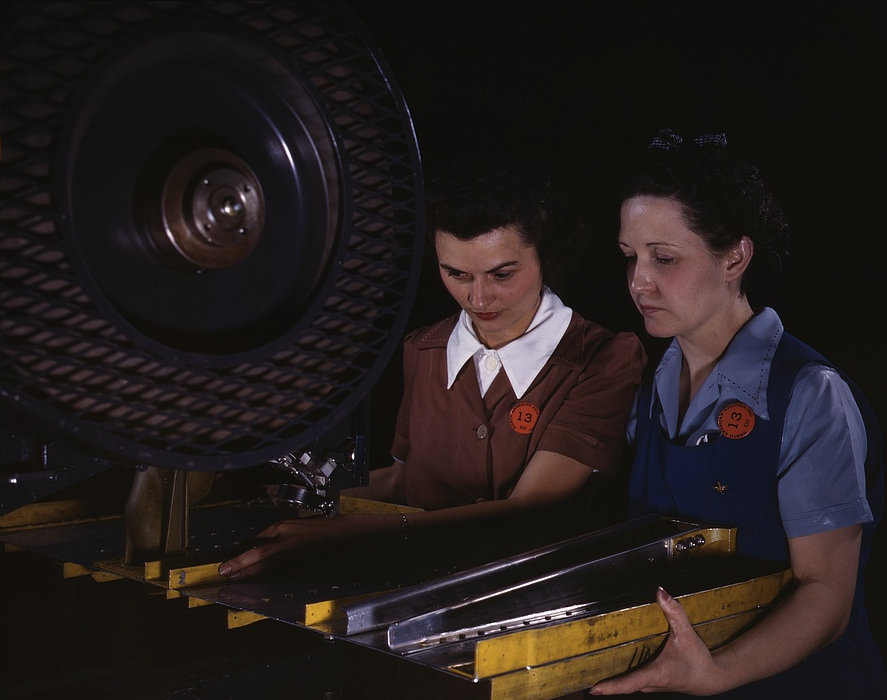 Punching rivet holes in a frame member for a B-25 bomber, the plant of North American Aviation, Inc., Calif. June 1942