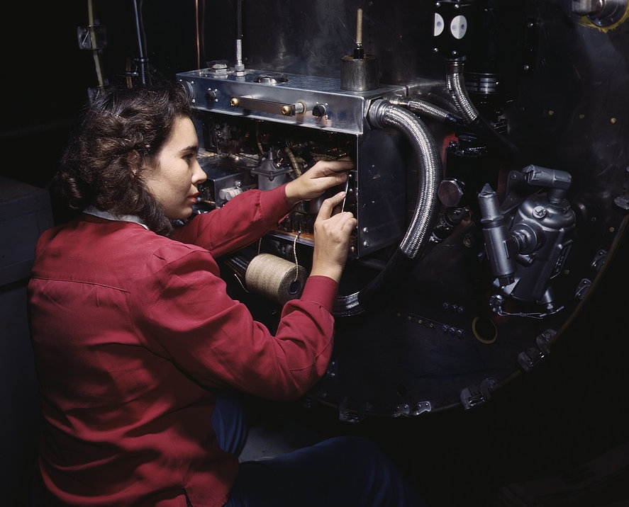 Switch boxes on the firewalls of B-25 bombers are assembled by women workers at North American [Aviation, Inc.]'s Inglewood, Calif., plant 1942