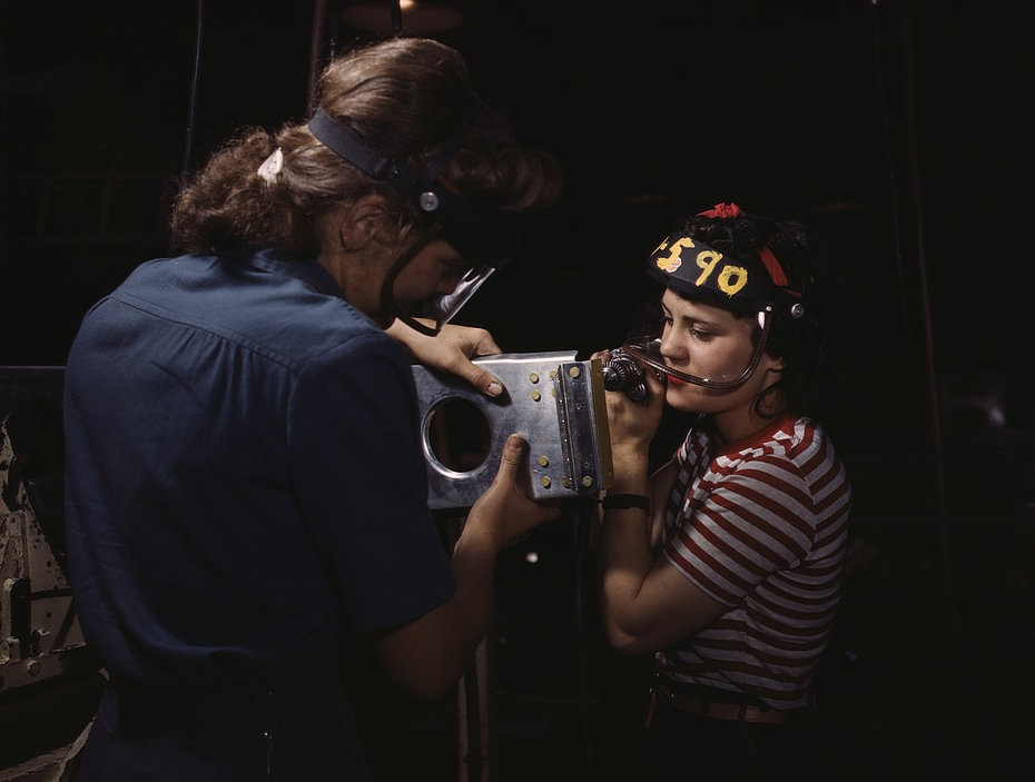 Two women employees of North American Aviation, Incorporated, assembling a section of a wing for a P-51 fighter plane Oct 1942