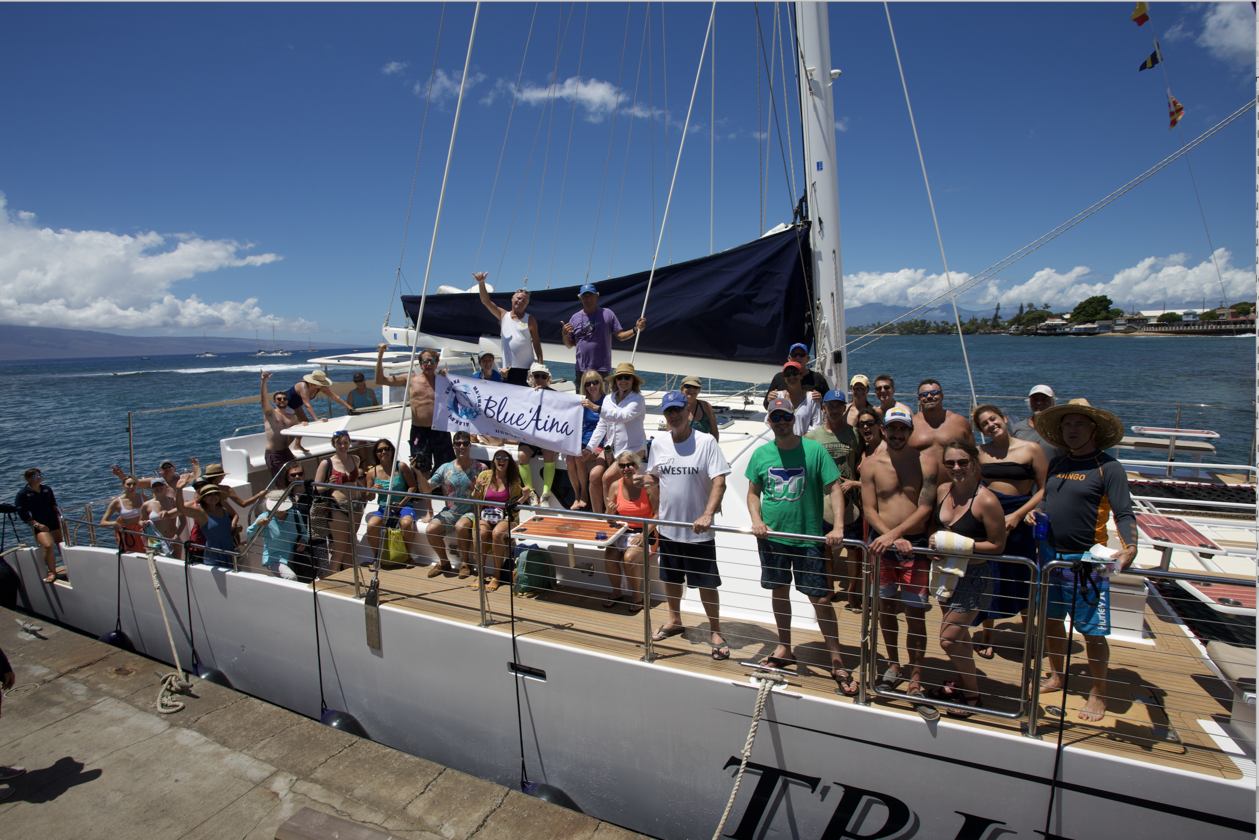 Blue'Aina Cleanup volunteers aboard Trilogy