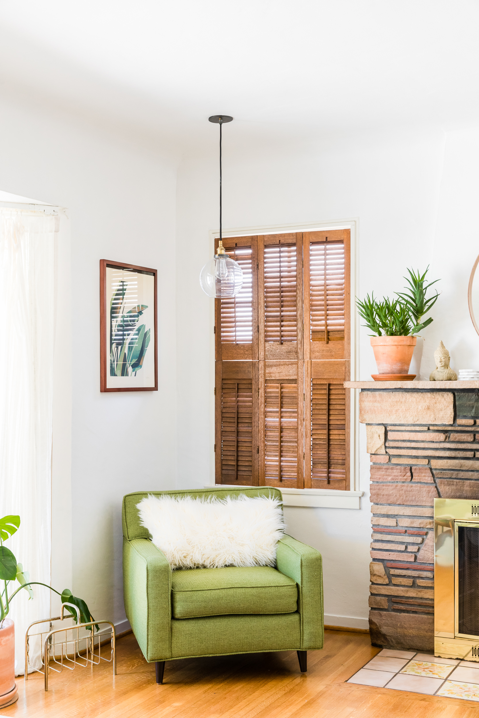 Mid century modern living room with glass pendant and green chair | Los Angeles interior photographer