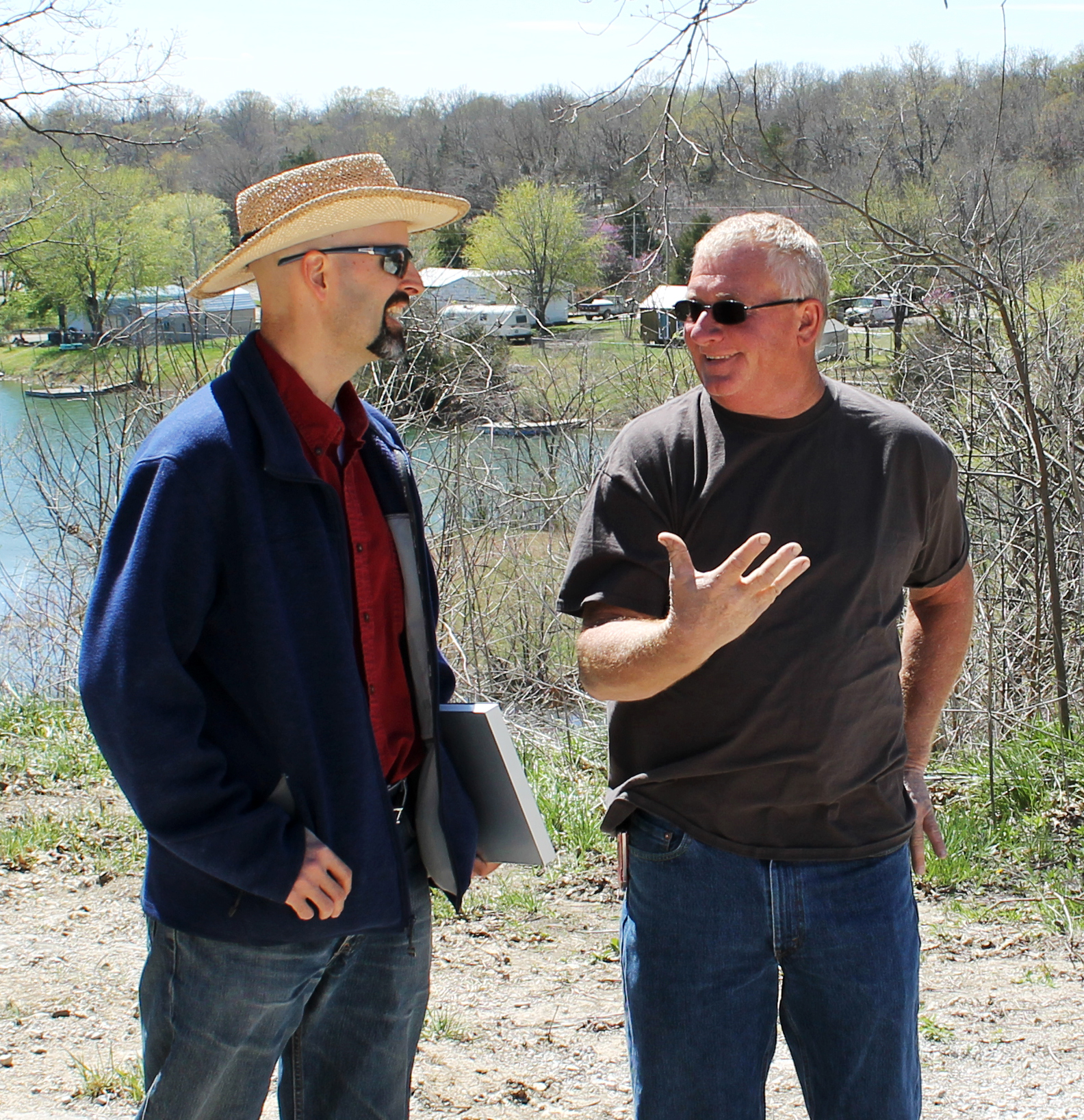 Shafer, Kline & Warren Team Leader Matt Eblen (left) discusses dam and stormwater management with Tanglewood Lakes Board Member Robert Lawrence (right) during a routine inspection.
