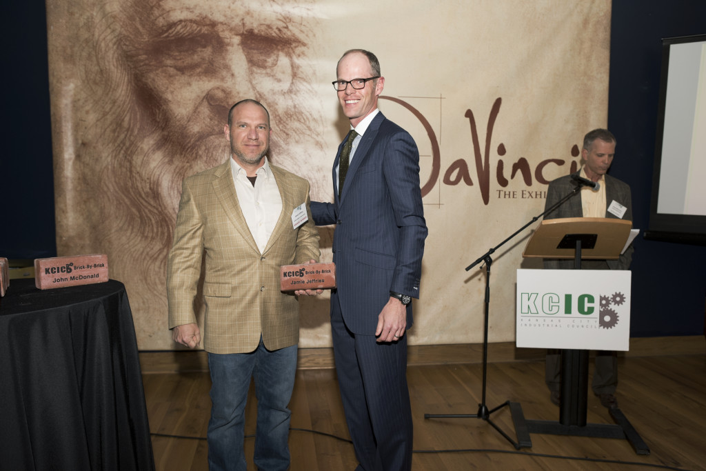 Jamie Jeffries (left) accepts KCIC's award for his and John McDonald's contributions to the East Bottoms.