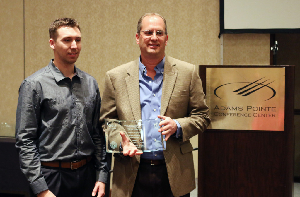 McCownGordon safety engineer Blaine Arbuckle and Safety Director Brian Schrader, Safety Director accept the first place award in the general contractor division at The Builders Association's 9th Annual Safety Excellence Awards.