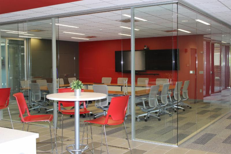 A glass-walled conference room in the center of the floor is equipped with all the latest audio/visual conferencing technology and is soundproofed to allow for private meetings.