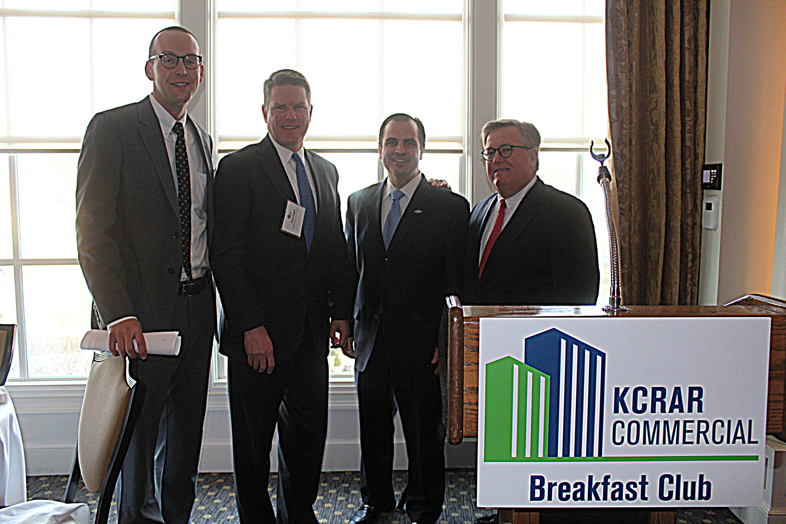 Phil Algrim of JLL, Paul Fogel of Karbank, Mike Bell of Hunt Midwest, and Whitney Kerr Jr. of DTZ.