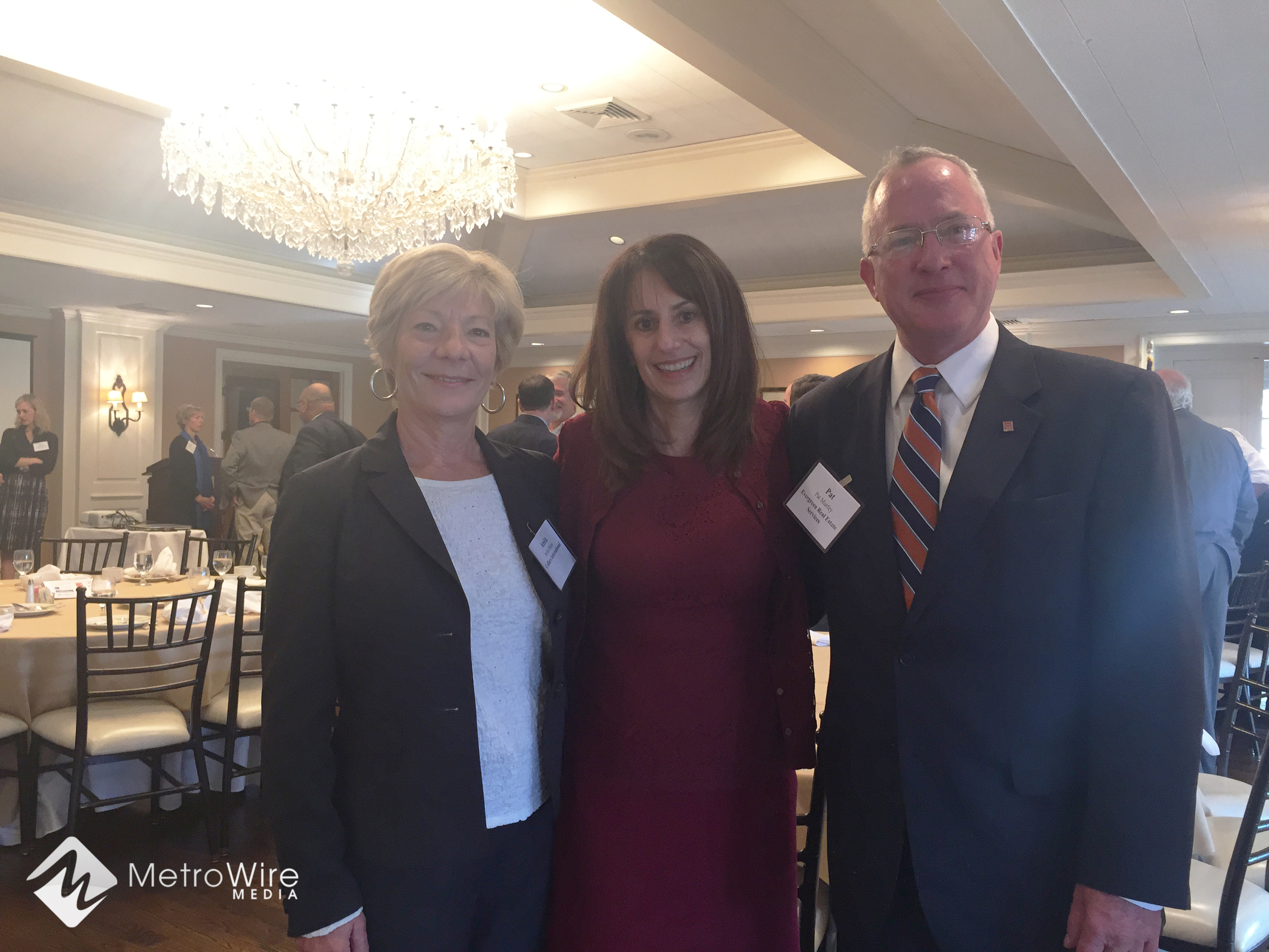 Ora Reynolds, president and CEO of Hunt Midwest, visits with CCIM Kansas City on Friday morning along with Anita Bates, Colliers (left) and Pat Murfey, Evergreen Real Estate Services.