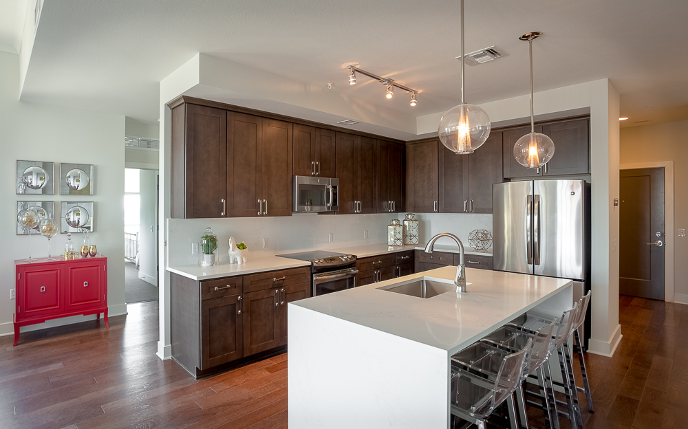 Amenities include wine lockers, a fitness facility, meditation chamber and wellness lounge, massage and red light therapy, valet dry cleaning and grocery delivery, housekeeping, concierge and room service, and personal training.