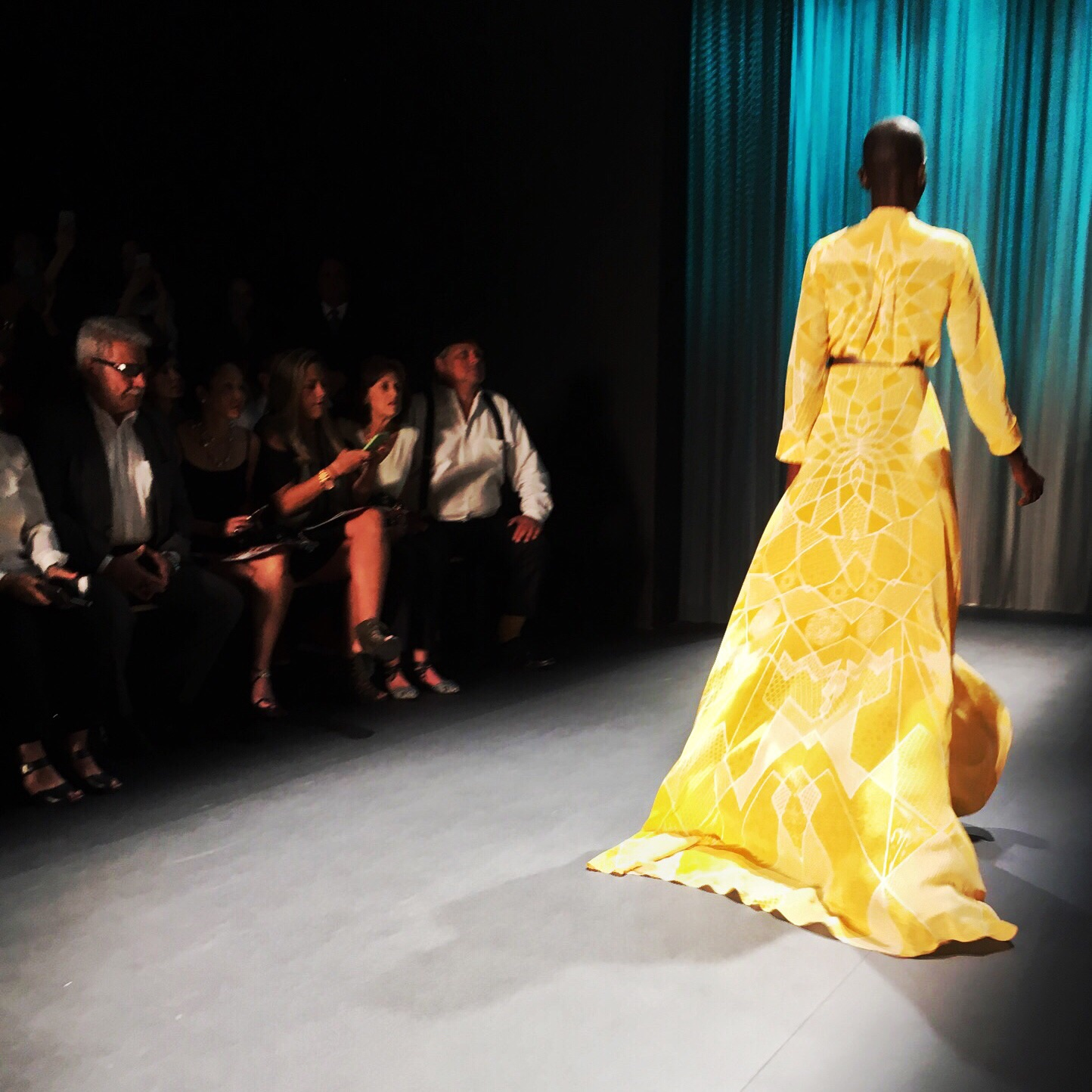 From the back... (Model is wearing a geometric patterned canary yellow gown)