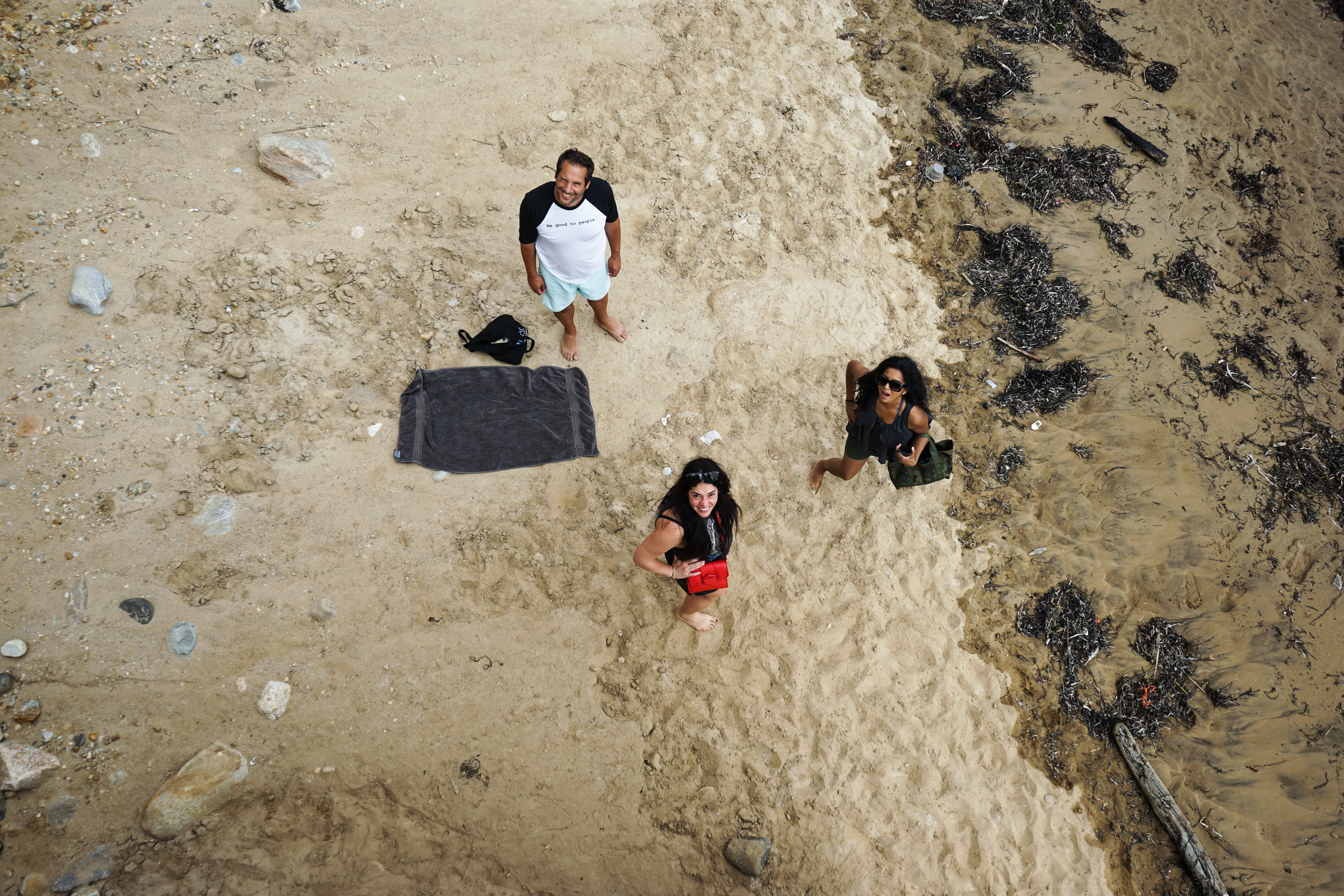 Aerial shot of Hitha Herzog, her husband Seth, and a friend on the beach below.