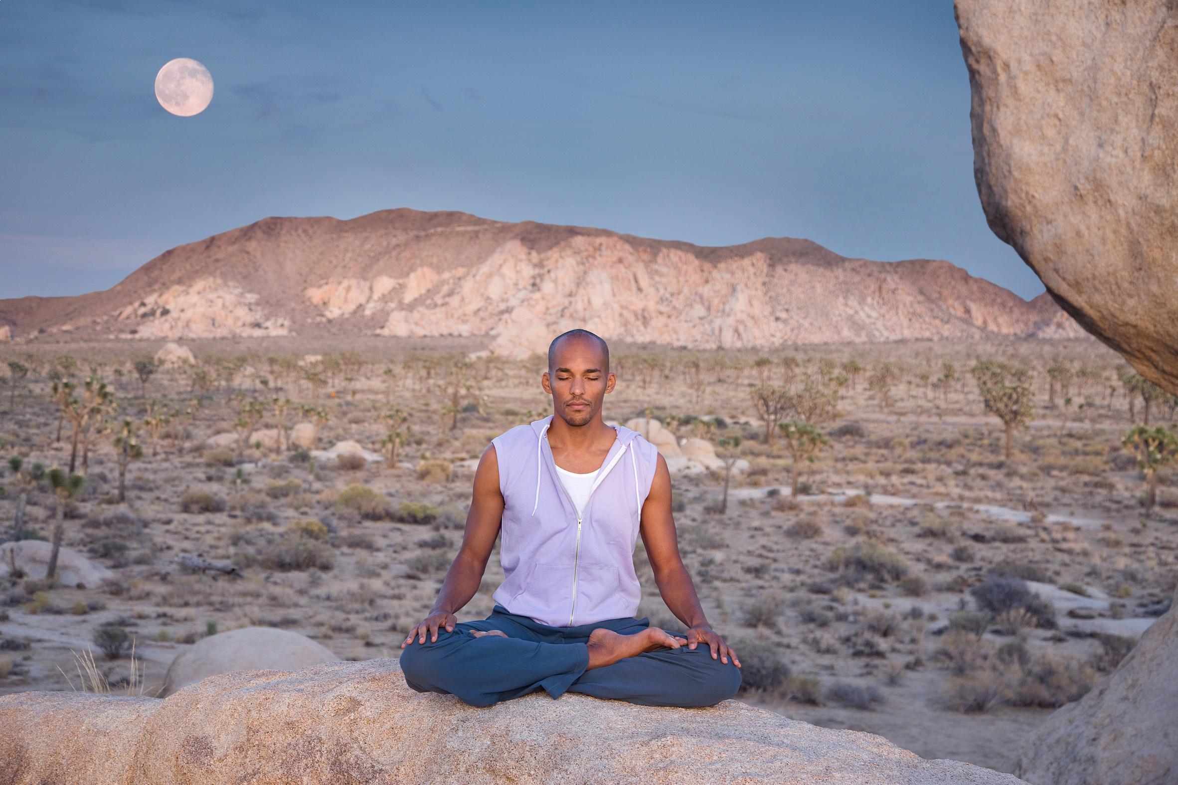 MEDITATING UNCOMFORTABLY ON A ROCK IN JOSHUA TREE, CALIFORNIA.