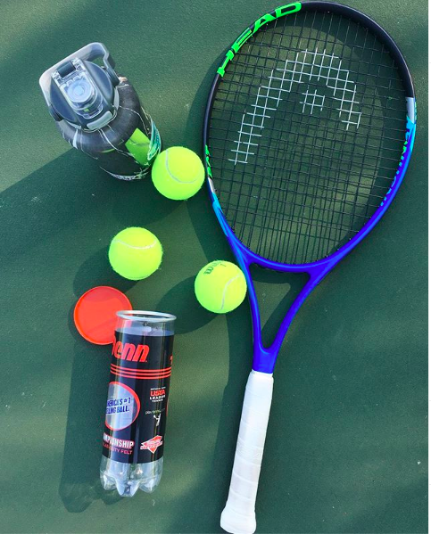 Playing Tennis - 5 Ways to Summer-izing My Fitness Goals and How You Can Too - GirlsGotGoalz.com