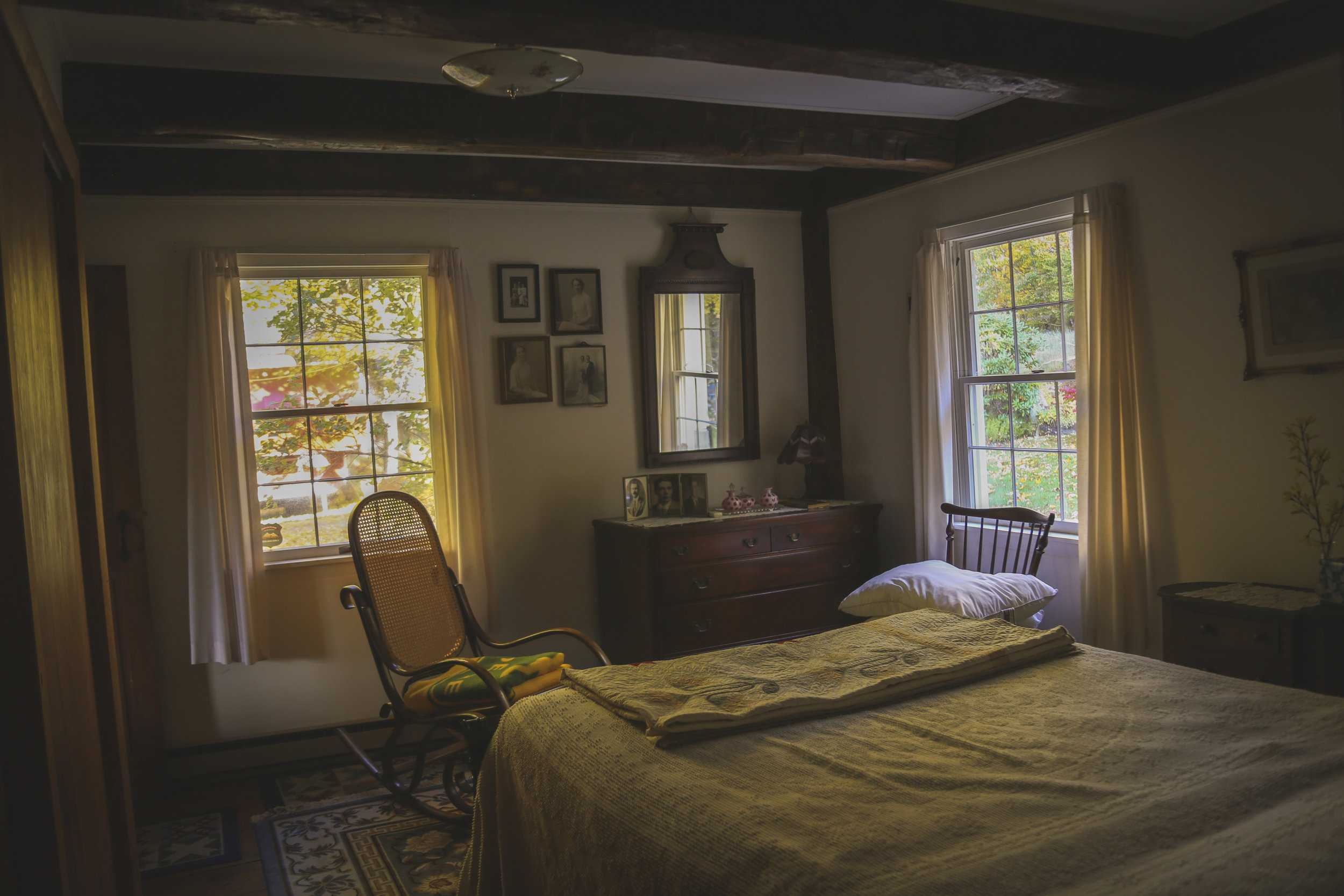 """One of the rooms that gave me the """"spooks"""" throughout my life. My great grandparents bedroom.The walls hold framed faces of past family members."""