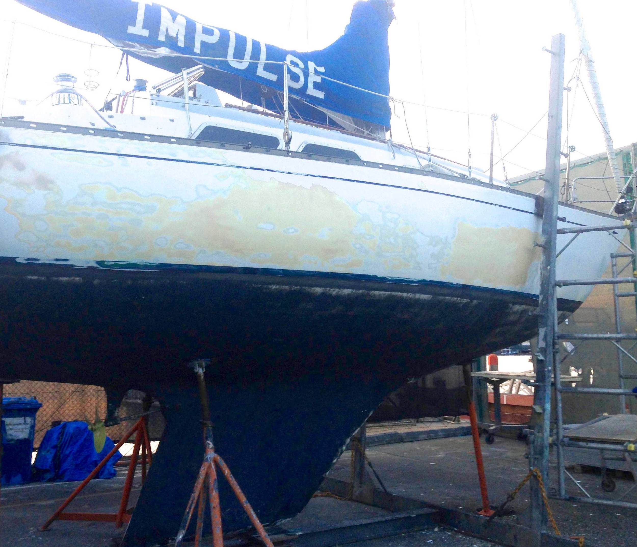 Scraping the old paint off Impulse's hull