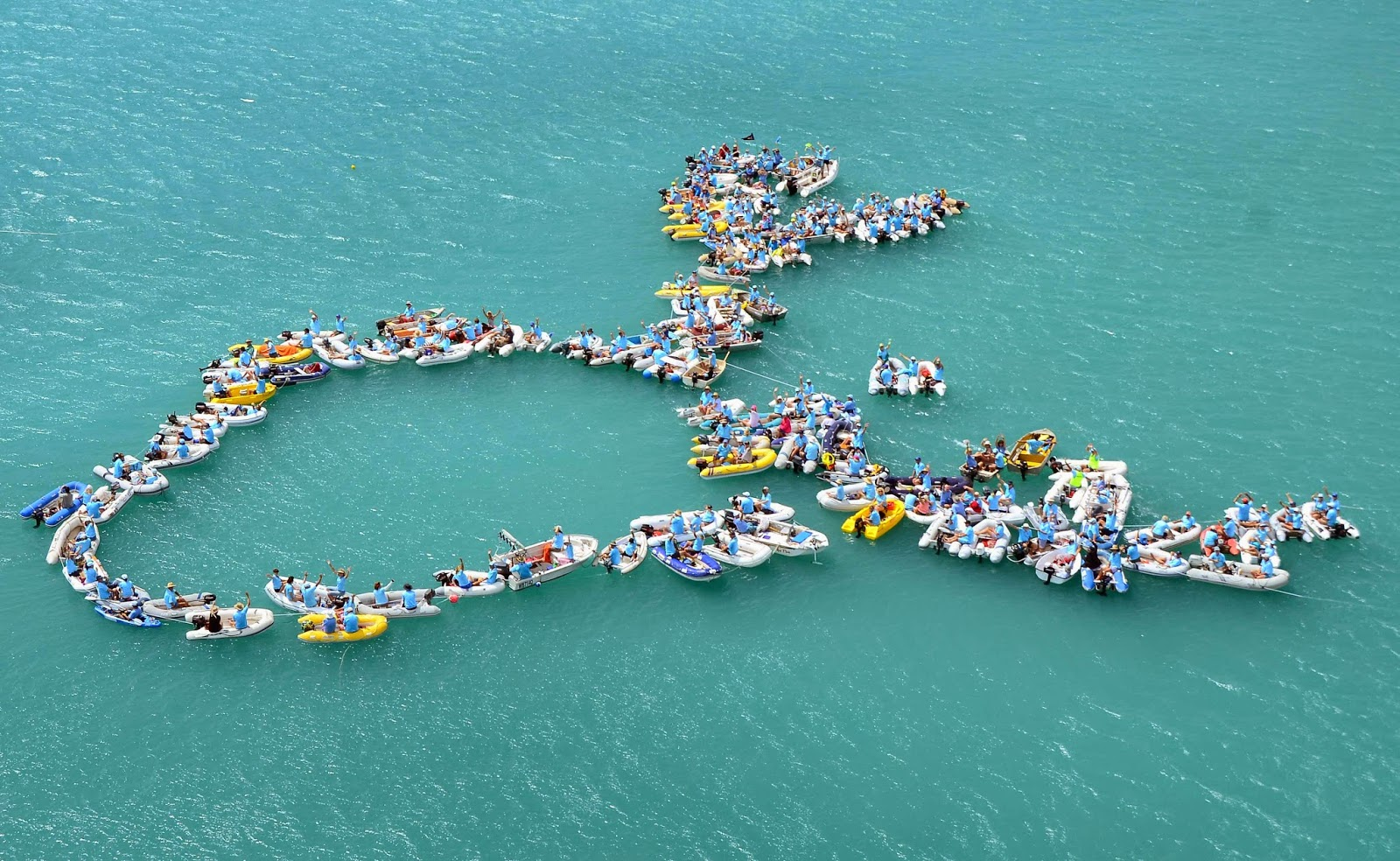 SICYC members form the Prostrate Cancer Foundation logo on the water each year