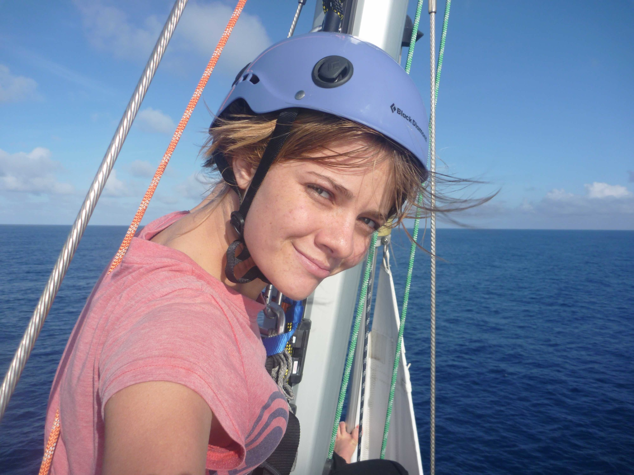 Jessica Watson inspecting the top of her mast on her circumnavigation