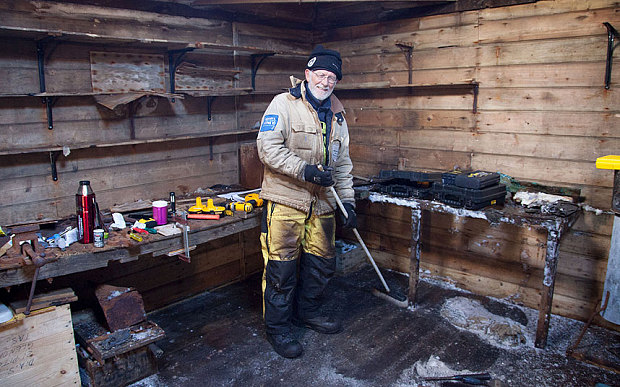 Mawson's Huts expedition conservator Peter Maxwell stands in the workshop section of Mawson's Hut. Photo: Reuters