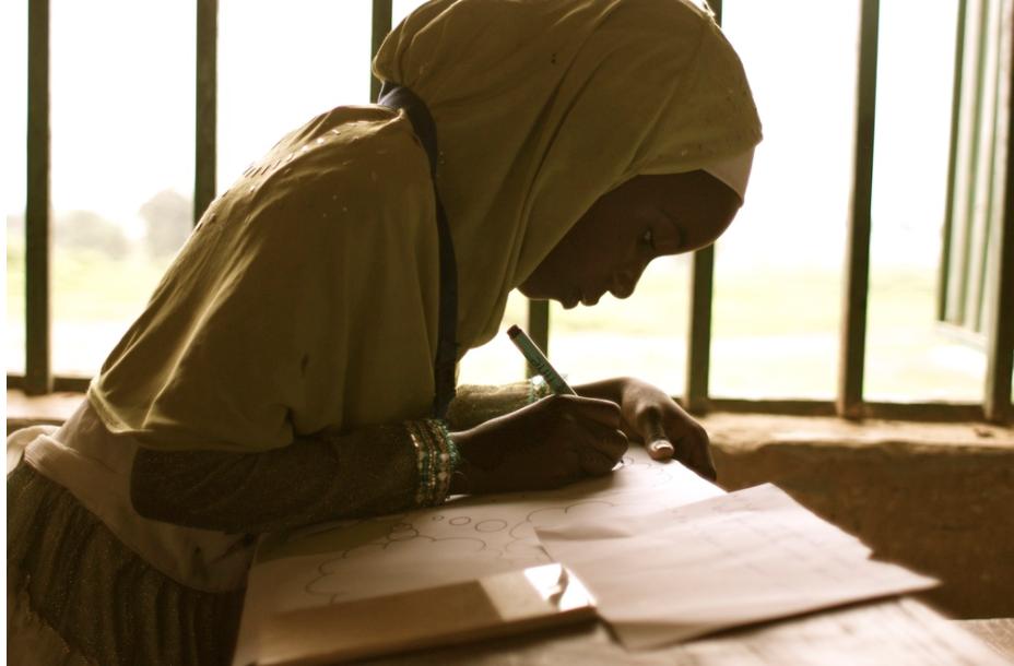 Sahelian young women writing.png
