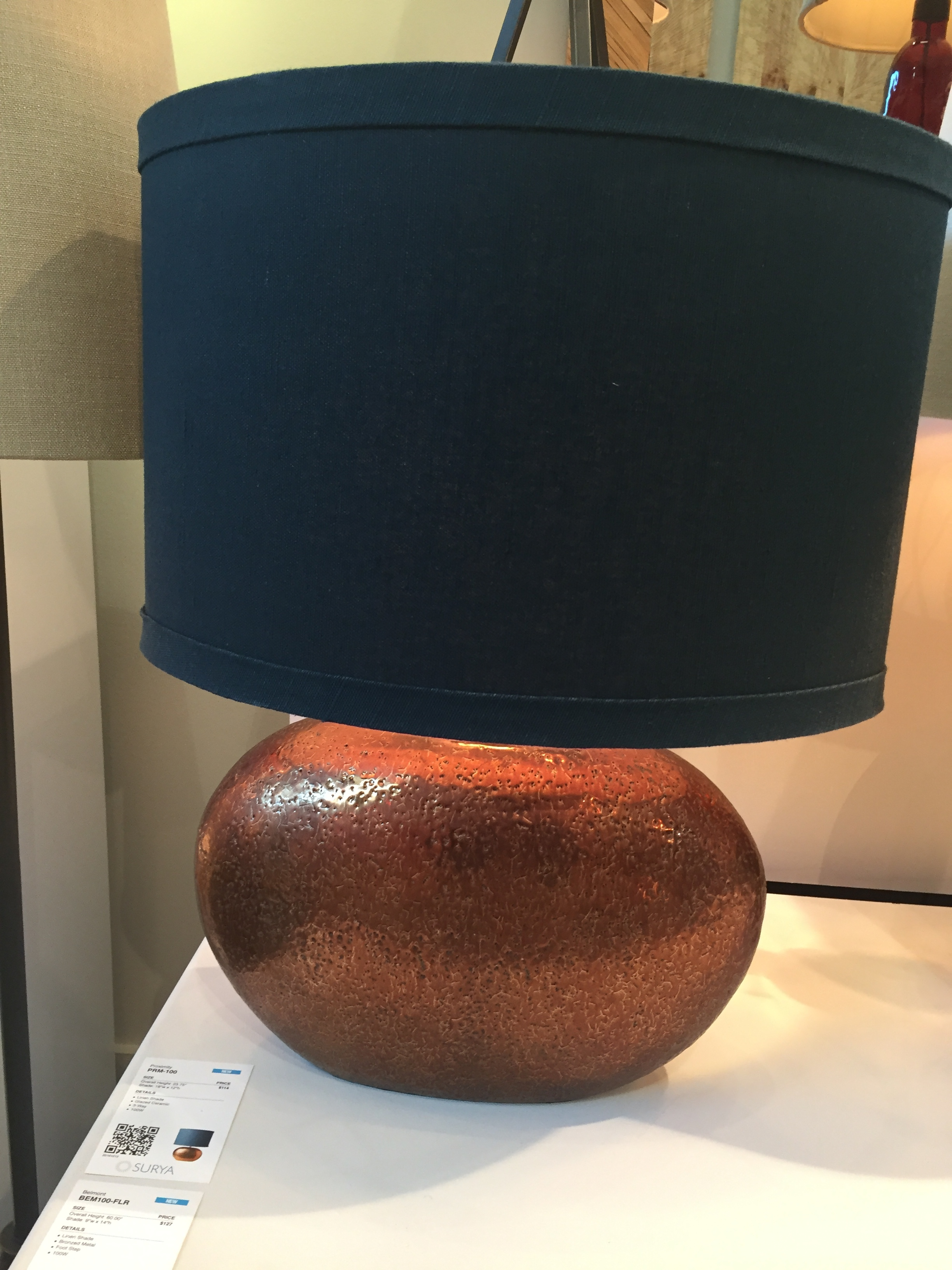 Bold and brassy...well...copper ceramic really! The bold navy blue shade and copper ceramic base from Surya is stunning!
