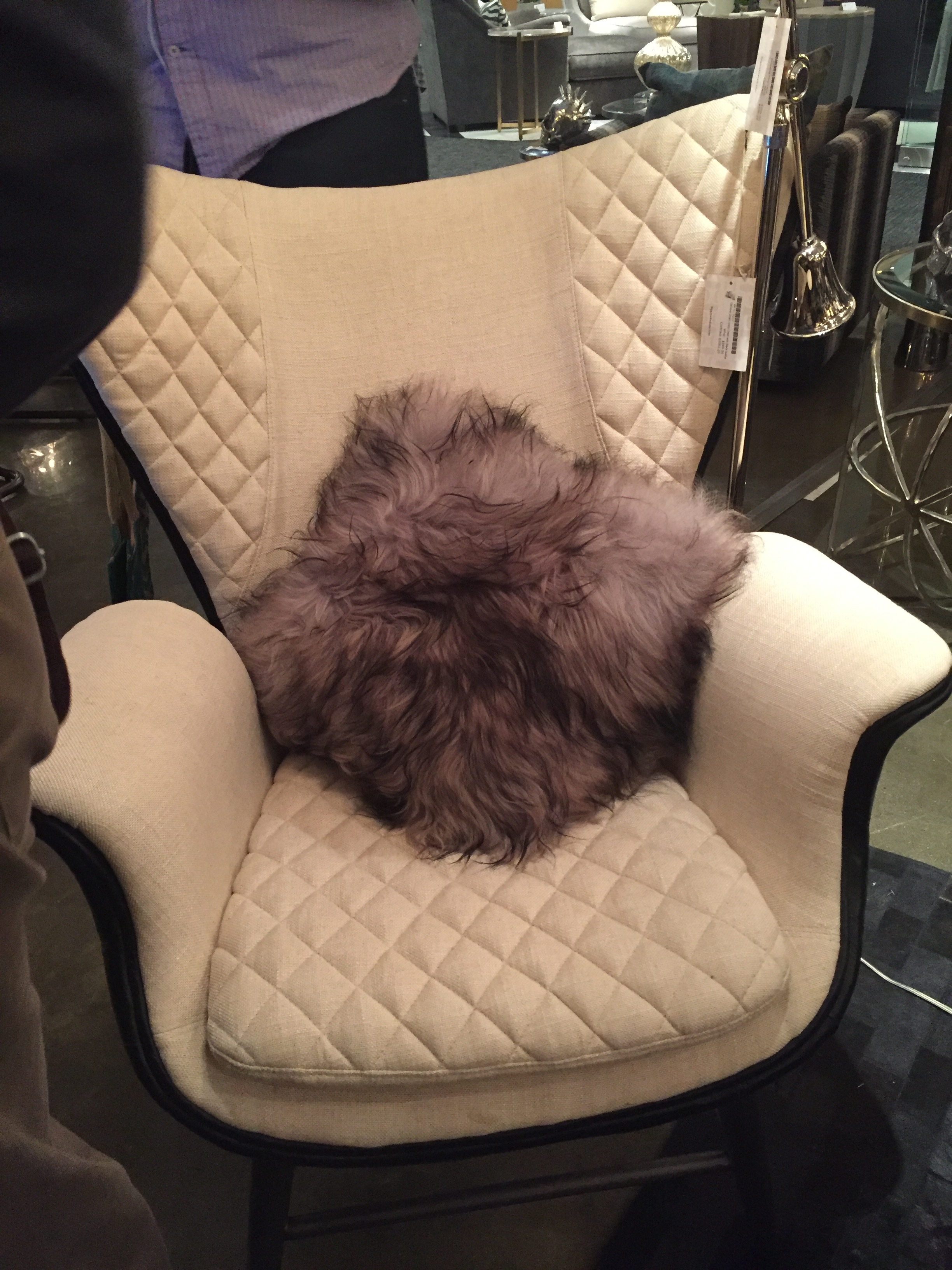 Not your typical tufting, but boy does it make a statement! Love the elements of this chair and fur pillow from Regina Andrew to add the drama necessary for the season.