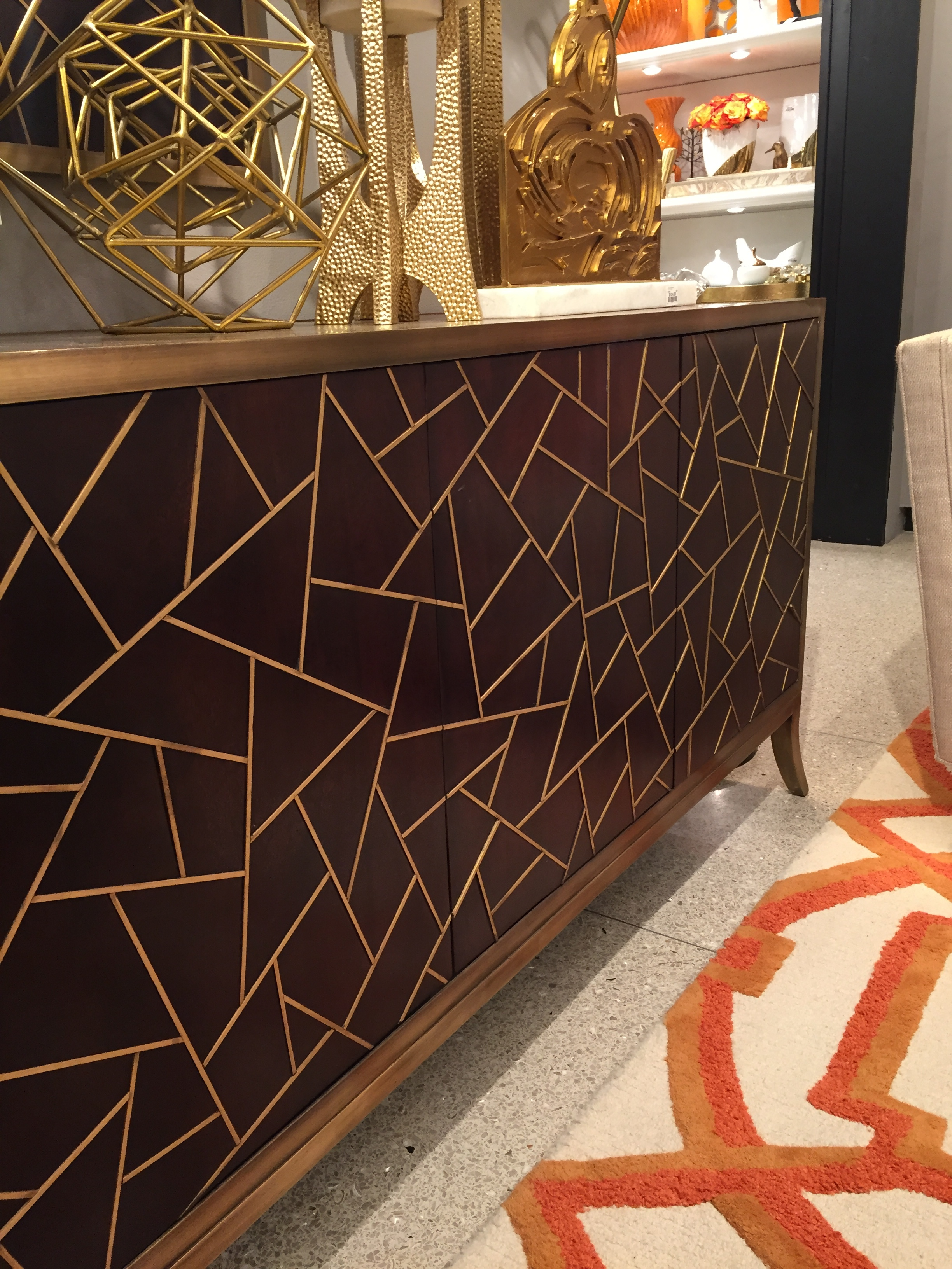 This tangier media cabinet from Global Views is a show stopper! The magnificent metal inlay on the doors is gorgeous. Paired with the geometric rug is fantastic!