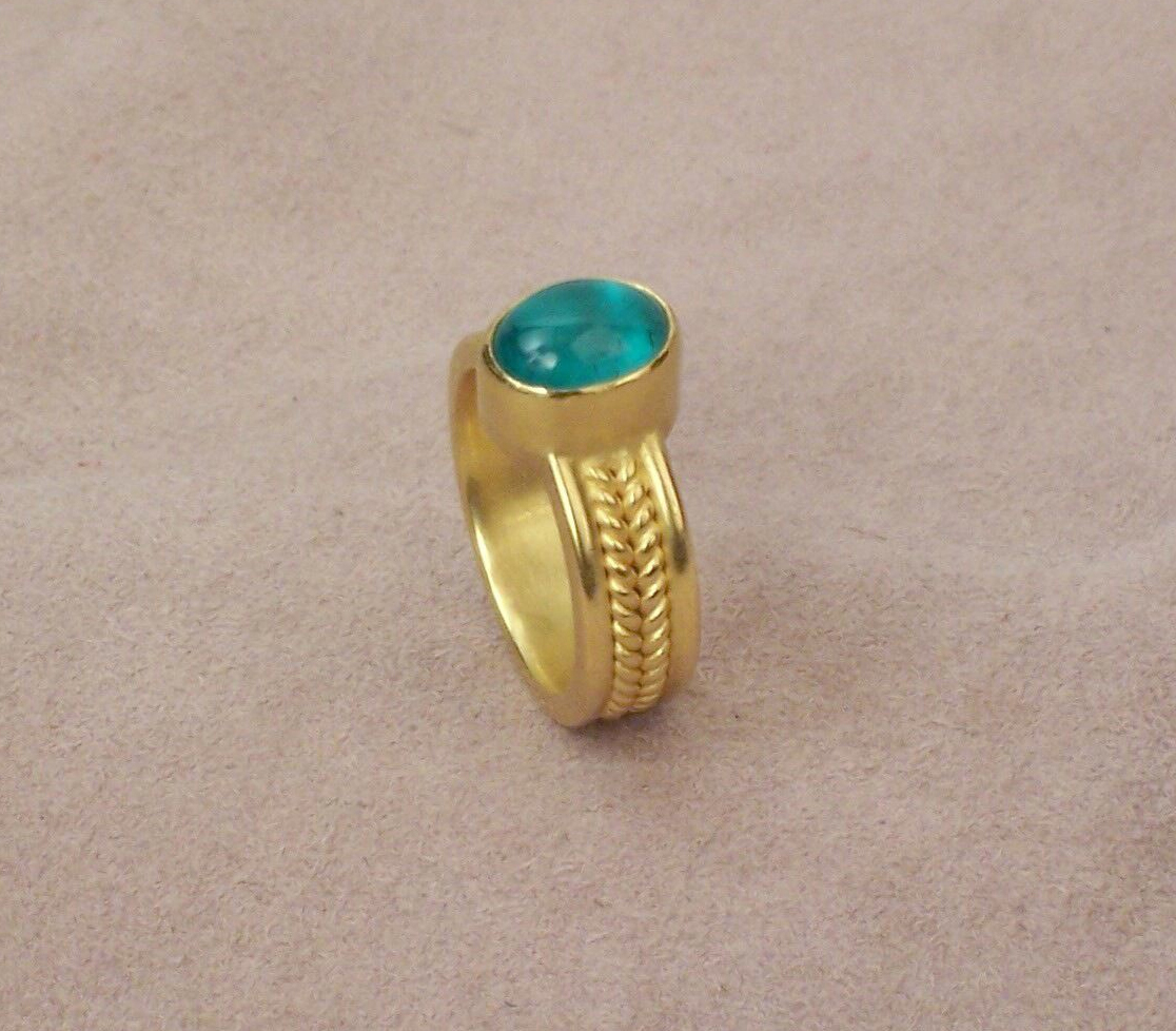 Emerald cabochon twisted wire and half-round band.
