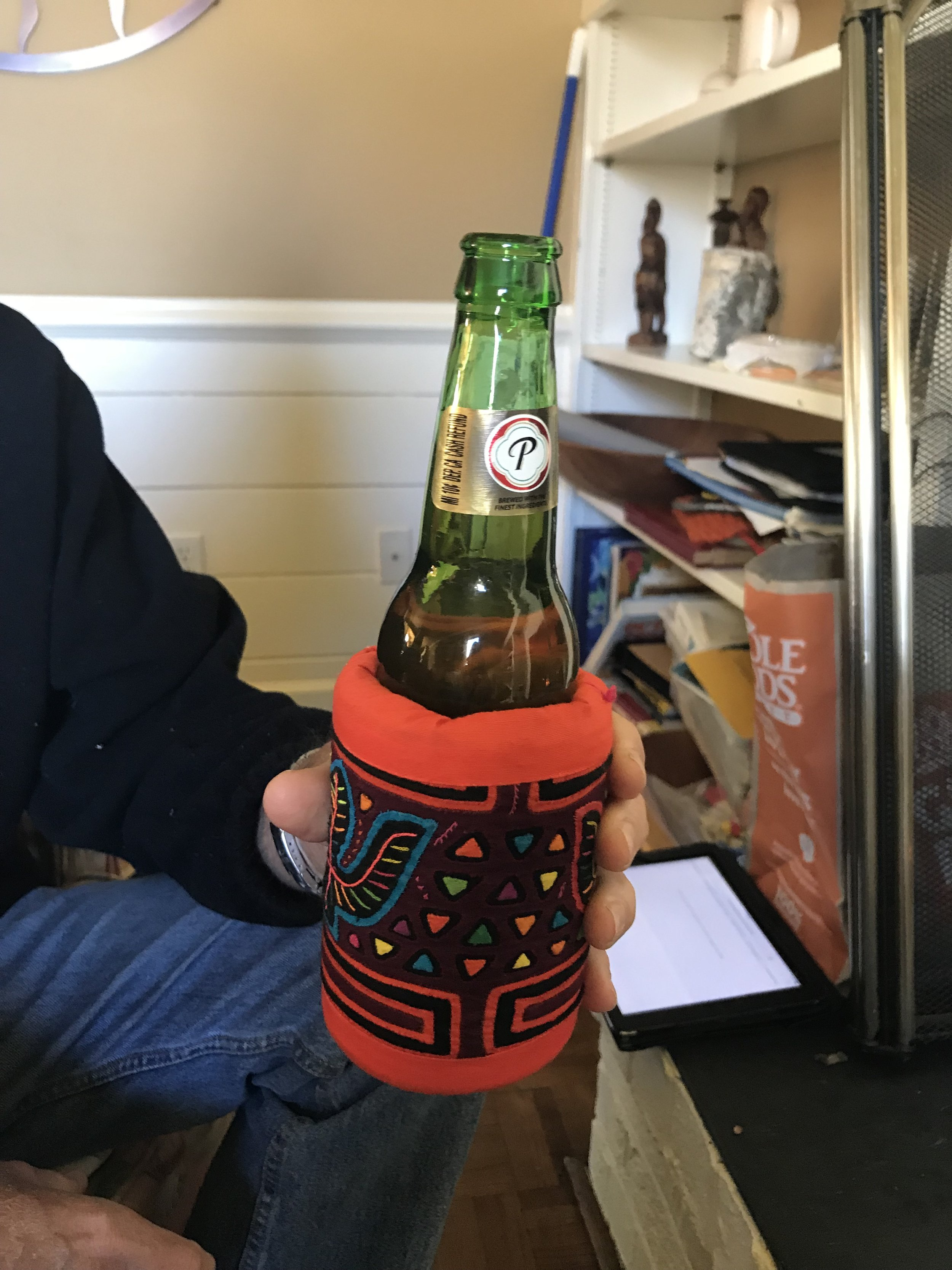 Drinking a Presidente out of a mola coozie