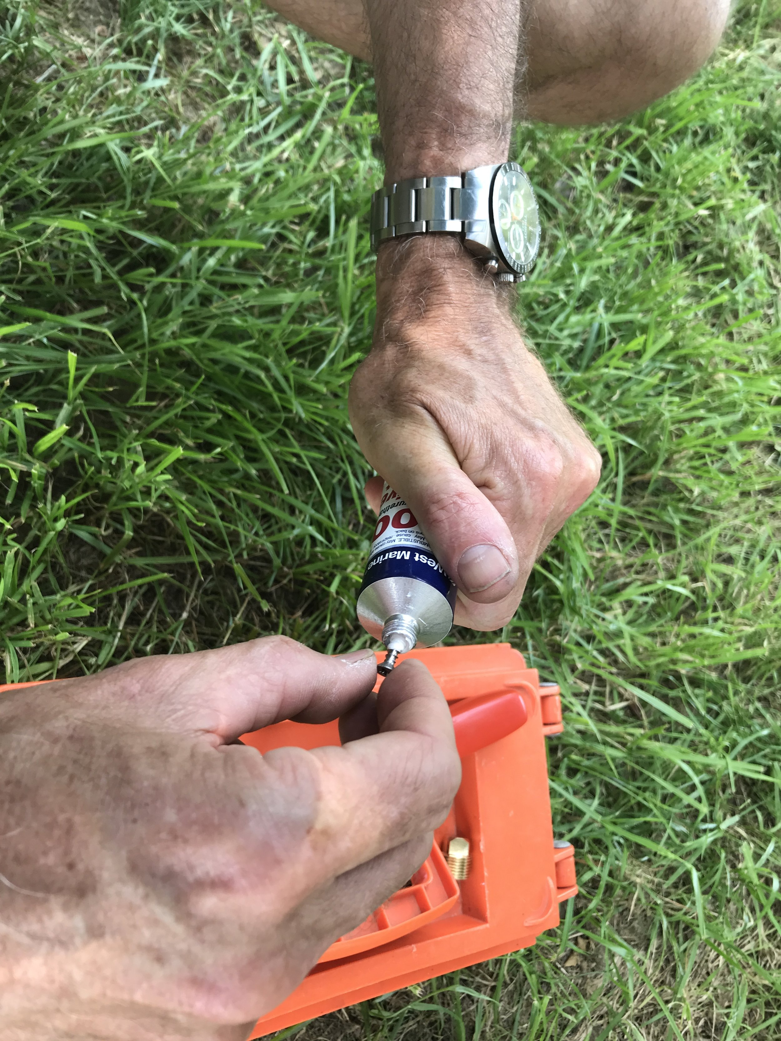 Apply sealant to the fastener - easily done by screwing the fastener into the tube.